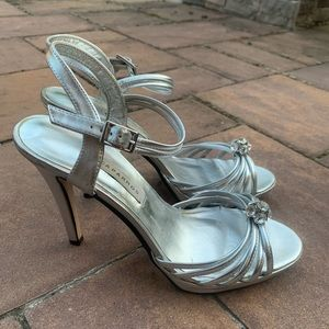 Caparro's Silver Heels with Crystal Center